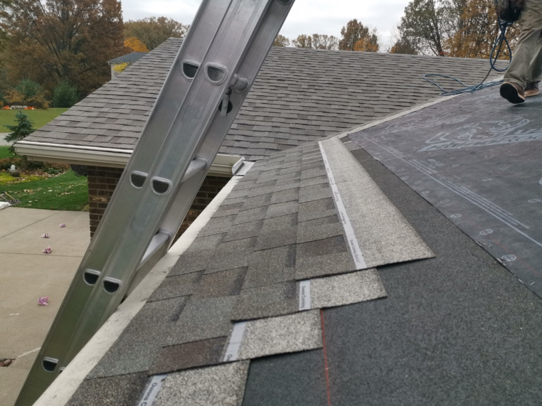 Complete your home with metal or asphalt roof installation